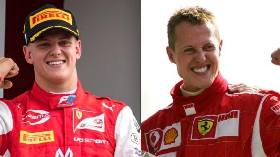 "This combination of pictures created on December 2, 2020, shows German Ferrari driver Michael Schumacher (R) celebrating on the podium of the Monza racetrack after the Italian Formula One Grand prix, in Monza, on September 10, 2006, and his son Prema Racing's German driver Mick Schumacher (L) celebrating after winning the Formula Two championship race of the Hungarian Grand Prix at the Hungaroring circuit in Mogyorod near Budapest, on August 4, 2019. - Mick Schumacher, the son of seven-time world champion Michael Schumacher, will drive in Formula One for the first time with Haas next season, the team announced on December 2, 2020, leaving their new recruit ""emotionally exploding"" at the realisation of a dream. (Photo by Andrej ISAKOVIC and Patrick HERTZOG / AFP) (Photo by ANDREJ ISAKOVIC,PATRICK HERTZOG/AFP via Getty Images)"