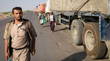 Trucks lined up on a road outside Hodeidah, fully laden but with no fuel to leave.