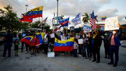 Venezuelans gather to celebrate the granting of a temporary protected status (TPS) by US President Joe Biden in front of El Arepazo restaurant in Miami, Florida on March 9, 2021. - The United States will allow potentially tens of thousands of Venezuelans to seek refuge, in a significant policy shift from the former Trump era, officials said March 8, 2021. Temporary Protected Status, or TPS, is being offered to people who fled political repression and economic chaos in the once wealthy South American country. (Photo by Eva Marie UZCATEGUI / AFP) (Photo by EVA MARIE UZCATEGUI/AFP via Getty Images)