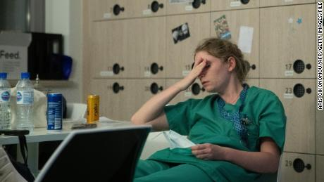 Health care workers around the world are feeling depressed and anxious from the stresses of the pandemic. Nurse Mathilde Dumont, 27, is shown at the Ixelles Hospital in Brussels.