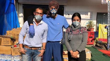 Singh, center, is pictured with other medical team members.