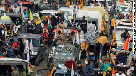 Farmers protest during a tractor rally near the Singhu border crossing in New Delhi, India, on January 26, 2021.