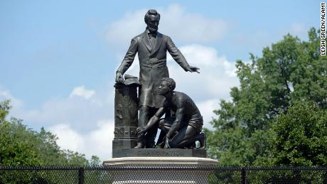 The controversial Emancipation Memorial on Capitol Hill in Washington. Some say its depiction of Lincoln looming over a slave is demeaning. The statue is protected by a fence to keep out protesters.