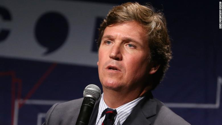 LOS ANGELES, CA - OCTOBER 21:  Tucker Carlson speaks onstage during Politicon 2018 at Los Angeles Convention Center on October 21, 2018 in Los Angeles, California.  (Photo by Rich Polk/Getty Images for Politicon )