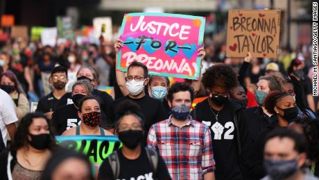 People march in Louisville, Kentucky, last year.