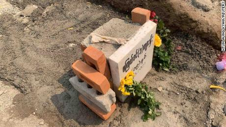 A glove is seen on the freshly-cemented grave of 19-year-old protester, Angel, also known as Ma Kyal Sin, on March 6, in Mandalay, Myanmar, after authorities exhumed her body.