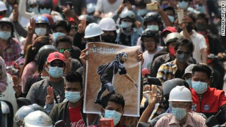 People display a poster of Angel during her funeral on March 4.