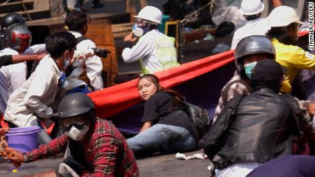 Angel lies on the ground before she was shot in the head as Myanmar's forces opened fire to disperse an anti-coup demonstration in Mandalay, on March 3.