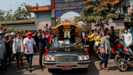 Angel's body is transported from the Yunnan Chinese temple in Mandalay, during her funeral on March 4.