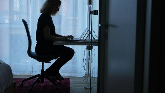 BERLIN, GERMANY - MARCH 01: The wife of the photographer works in home office during the coronavirus pandemic on March 01, 2021 in Berlin, Germany. German authorities have confirmed the country has entered a third wave of the pandemic due to the spread of the B117 variant of the novel coronavirus. Meanwhile the pace of vaccinations has begun accelerating and some lockdown measures have been cautiously eased. (Photo by Sean Gallup/Getty Images)