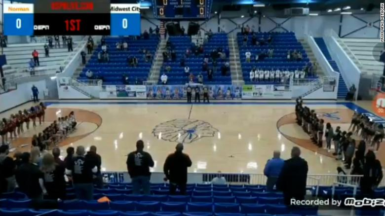 An announcer hurled racial insults at a high school basketball team for kneeling during the National Anthem