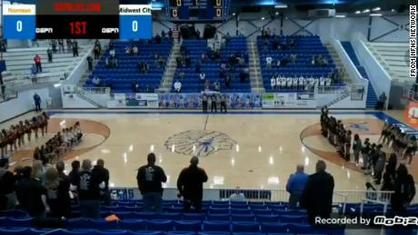 An announcer hurled racist insults at a high school basketball team for kneeling during the National Anthem
