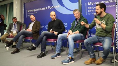 Russian opposition activists (from right) Ilya Yashin, Yevgeny Roisman, Andrei Pivovarov and Vladimir Kara-Mursa speak during a forum hosted by the United Democrats in Moscow before it was broken up by police on Saturday, March 13.