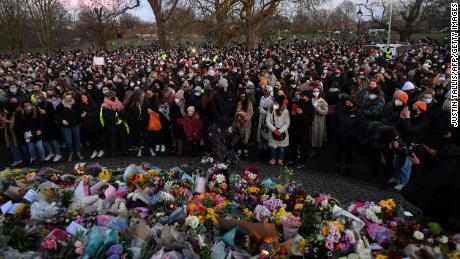 Mourners laid flowers and put down candles at the memorial in Clapham.