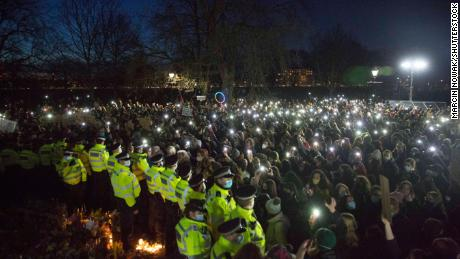 Crowds gather at a makeshift memorial to Everard in Clapham in south London, where she was last seen.