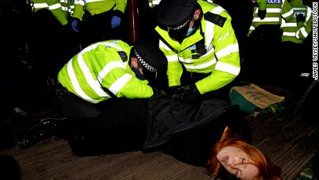 A woman is arrested at a vigil on Saturday in memory of murdered Londoner Sarah Everard.