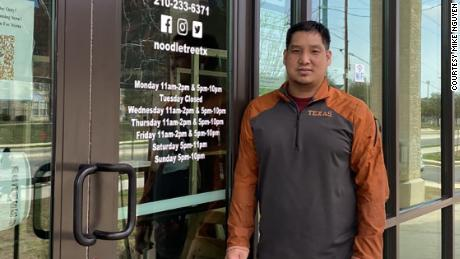 Mike Nguyen stands outside his San Antonio restaurant, Noodle Tree.