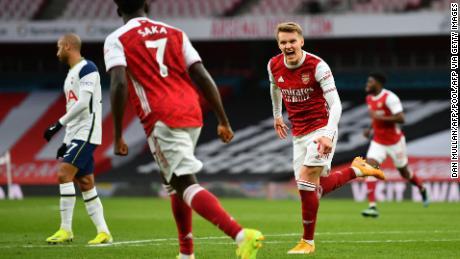 Ødegaard (right) celebrates after scoring the equalizing goal against Tottenham.