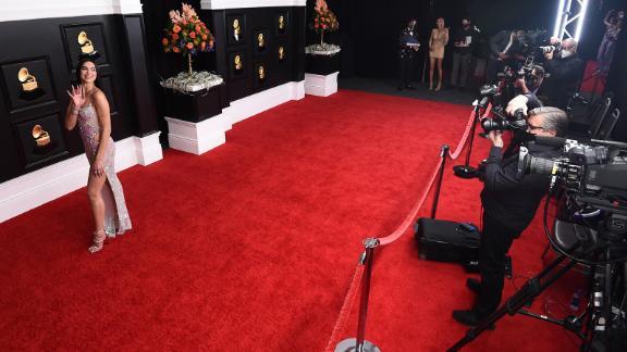 Dua Lipa walks the red carpet at the event.