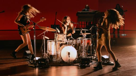"""Haim rocks out during one of the show's opening numbers. The band played """"The Steps."""""""