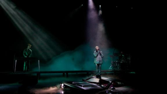 """The spotlight shines on Eilish as she and Finneas perform """"Everything I Wanted"""" at the beginning of the show."""