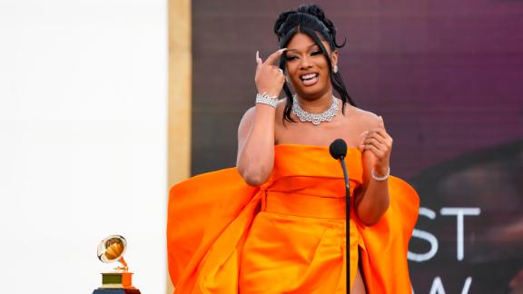 Megan Thee Stallion accepts the award for best new artist on Sunday. It was the first award presented during the broadcast.