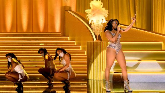"""Megan Thee Stallion is joined by backup dancers during a performance of """"Savage Remix."""" Megan also won the Grammys for best new artist and best rap song (""""Savage"""")."""