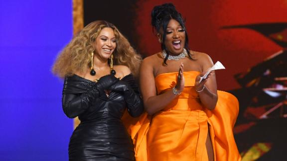 """Beyoncé joins Megan Thee Stallion to accept the Grammy for best rap performance (""""Savage"""")."""