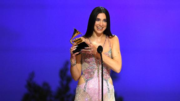 "Dua Lipa accepts the Grammy for best pop vocal album (""Future Nostalgia"")."