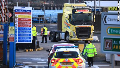 Customs officials check vehicles at the P&O ferry terminal at the Port of Larne in Northern Ireland on January 1, 2021.