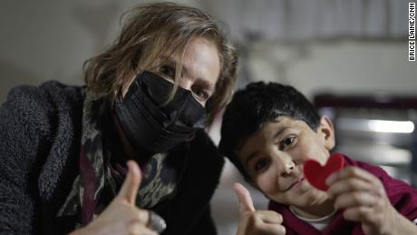 CNN's Arwa Damon with 10-year-old Sultan who suffered from burns after an attack near him in Idlib.