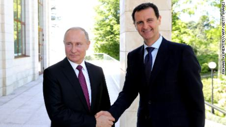 Russian President Vladimir Putin shakes hands with his Syrian counterpart Bashar al-Assad during a meeting in Sochi on May 17, 2018.