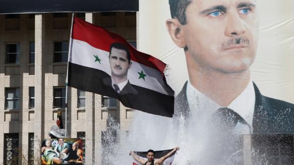 Supporters of al-Assad celebrate during a referendum vote in Damascus on February 26, 2012. Opposition activists reported at least 55 deaths across the country as Syrians headed to the polls. Analysts and protesters widely described the constitutional referendum as a farce.