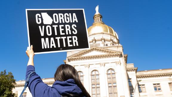ATLANTA, GA - MARCH 03: Demonstrators stand outside of the Georgia Capitol building, to oppose the HB 531 bill on March 3, 2021 in Atlanta, Georgia. HB 531 will add controversial voting restrictions to the state's upcoming elections including restricting ballot drop boxes, requiring an ID requirement for absentee voting and limiting weekend early voting days. The Georgia House passed the bill and will send it to the Senate. (Photo by Megan Varner/Getty Images)