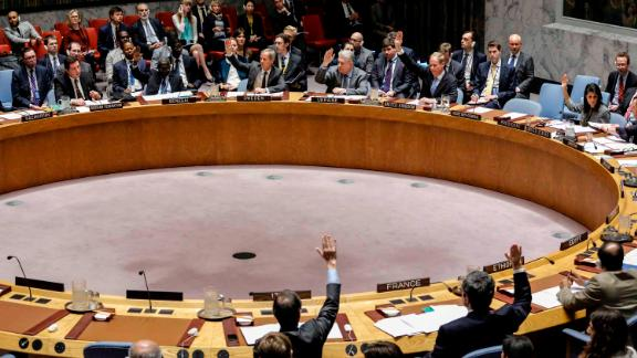 Members of the UN Security Council raise their hands on April 12, 2017, as they vote in favor of a draft resolution that condemned the reported use of chemical weapons in Syria.