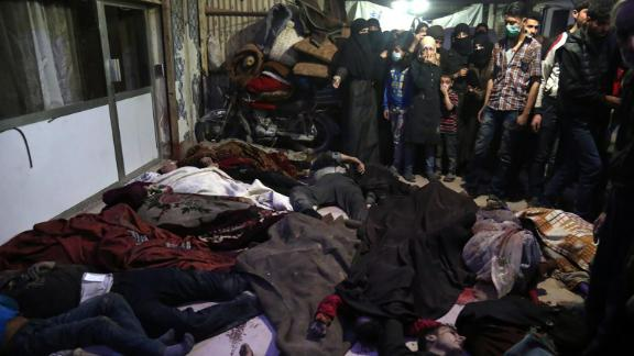 """Bodies lie on the ground in the rebel-held city of Douma, Syria, on April 8, 2018. <a href=""""https://www.cnn.com/2018/04/11/middleeast/syria-chemical-attack-500-affected-who-intl/index.html"""" target=""""_blank"""">According to activist groups,</a> helicopters dropped barrel bombs filled with toxic gas on Douma, which has been the focus of a renewed government offensive that launched in mid-February. The Syrian government and its key ally, Russia, vehemently denied involvement and accused rebel groups of fabricating the attack to hinder the army's advances and provoke international military intervention."""