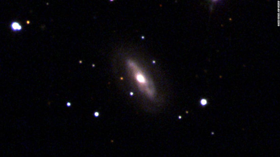This image from the Sloan Digital Sky Survey shows the galaxy J0437+2456, which includes a supermassive black hole at its center that appears to be moving.