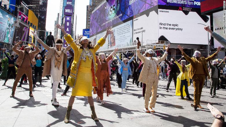 Theater community reunites for pop-up show in Times Square exactly one year after Broadway went dark due to pandemic