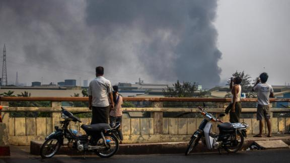 Smoke billows from the industrial zone of the Hlaing Tharyar township in Yangon on March 14. The Chinese Embassy in Myanmar said several Chinese-funded factories were set ablaze during protests. Demonstrators have accused Beijing of supporting the coup and junta.