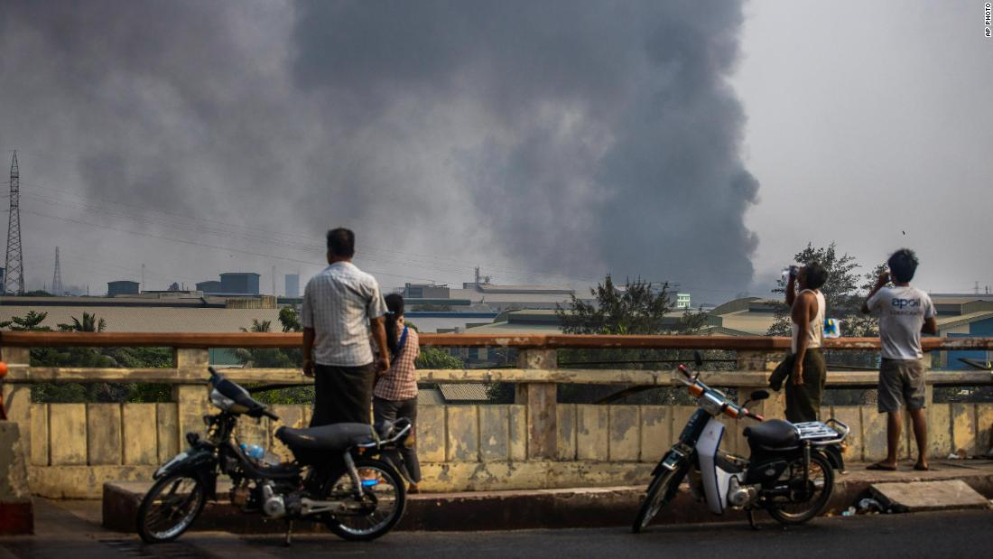 "Smoke billows from the industrial zone of the Hlaing Tharyar township in Yangon on March 14. The Chinese Embassy in Myanmar said several <a href=""https://edition.cnn.com/2021/03/15/asia/myanmar-deaths-chinese-factories-intl-hnk/index.html"" target=""_blank"">Chinese-funded factories were set ablaze</a> during protests. Demonstrators have accused Beijing of supporting the coup and junta."