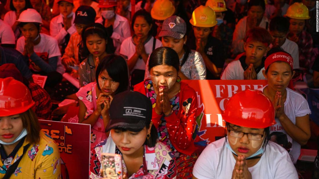 Anti-coup protesters pray in Yangon on March 14.