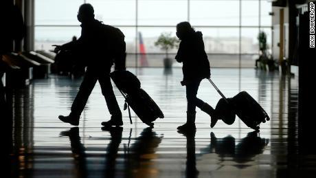 Travelers last week walk through the Salt Lake City International Airport.