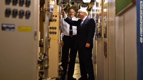 Commander Justin Codd, left, chats with British Prime Minister Boris Johnson  aboard Vanguard-class submarine HMS Victorious during a visit to the Faslane naval base  north of Glasgow, Scotland on July 29, 2019.