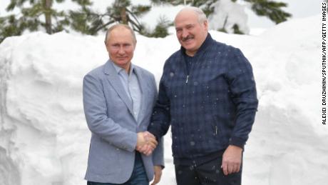 Russian President Vladimir Putin, left, shakes hands with Belarus President Alexander Lukashenko in Sochi on February 22.