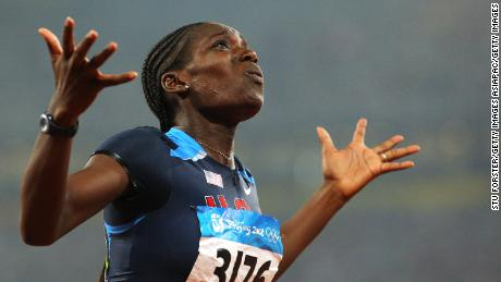 Harper-Nelson celebrates winning gold at the 2008 Olympics.
