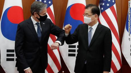 US Secretary of State Antony Blinken bumps elbows with South Korean Foreign Minister Chung Eui-yong in Seoul on March 18.