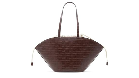 Who carries what Kory synthetic leather bag