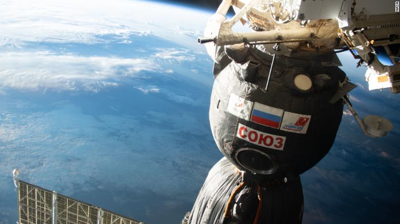 Watch astronauts relocate a spacecraft outside the International Space Station