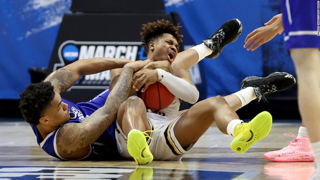 "Drake's Darnell Brodie, left, and Wichita State's Tyson Etienne battle for a loose ball during their ""First Four"" play-in game. Drake won 53-52 for its first NCAA Tournament win in 50 years."