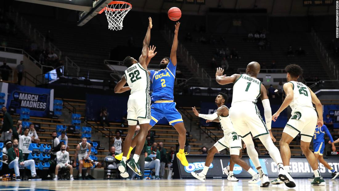UCLA's Cody Riley shoots the ball over Michigan State's Mady Sissoko.
